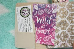 "Inside pocket, business card to a shop in Colorado and ""Wild at Heart"" card from Yellow Paper House"